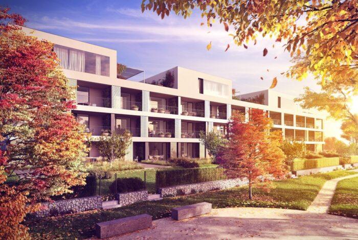 Pohled na podzimní zahradu před moderním bytovým domem Bleriot od atelieru Flera